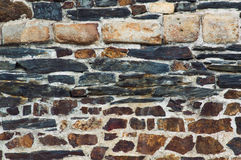 Wall made of different stones Stock Image