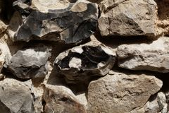 Wall made of flint stone Stock Images