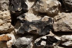 Wall made of flint stone Stock Image