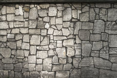 The wall is made from fragments of monuments royalty free stock photo