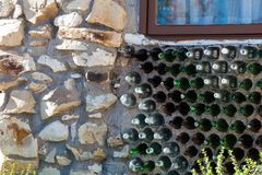 Wall made of green and brown glass bottles royalty free stock image