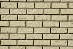 Wall made of grey bricks with dark seams Royalty Free Stock Images