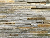 Wall made of grey oblong shape rocks Royalty Free Stock Photo