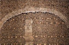The wall made of human bones and skulls Royalty Free Stock Photos