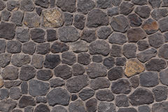 Wall made of lava stones Stock Photo