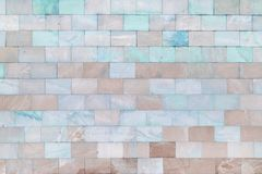 The wall is made of marble turquoise and pale brown tiles. Beautiful stone texture. Empty background. The wall is made of marble turquoise and pale brown tiles royalty free stock photo