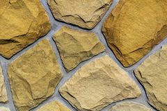 Wall made of natural limestone. Irregular stones surface. Seamle. Ssr old stone texture background Stock Photography