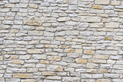 Wall made of natural limestone. Stock Image