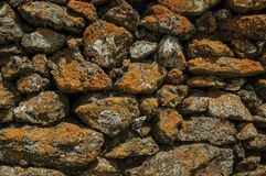 Free Wall Made Of Stones With Moss And Lichens Stock Images - 145160604