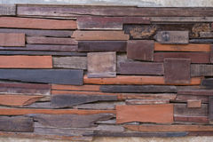 Wall made  by pieces of woods. Patched, nailed and stick up on the wall to make different texture. Vintage Stock Photo