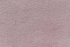 The wall is made of plaster and painted pink or beige paint. Royalty Free Stock Images