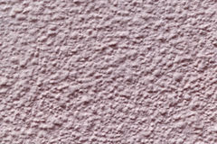The wall is made of plaster and painted pink or beige paint. Royalty Free Stock Photo