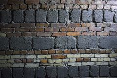 Old grunge red brick and concrete block wall background royalty free stock photo