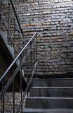 Old grunge brick wall background with stairs royalty free stock image
