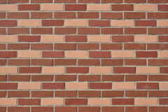 Wall made of red and pink bricks Stock Photos
