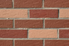 Wall made of red and pink bricks Royalty Free Stock Photography