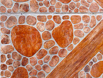 Wall made of red stone. As a background Royalty Free Stock Photography
