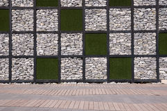 Wall made from rock and artificial grass Stock Photos