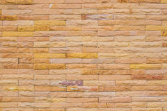Wall made from sandstone bricks, abstract background Stock Image