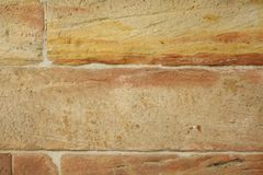 Wall made from sandstone bricks as background Royalty Free Stock Images