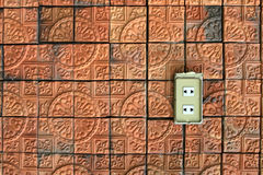 The wall made from stone. The wall made from the stone with the power outlet Royalty Free Stock Images