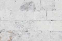 Wall made of stone blocks carelessly painted in white. As a background Royalty Free Stock Photos