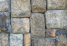 Wall made from stone rock Stock Images