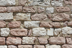 Wall made from stones of the Mount Subasio in Italy Royalty Free Stock Image