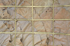 Wall that made by teak's leaf and bamboo Stock Photos