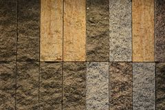 Wall made of various natural stone, empty background or wallpaper Royalty Free Stock Photography