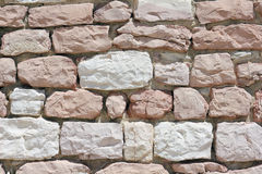 Wall made from white and pink limestone Stock Photos