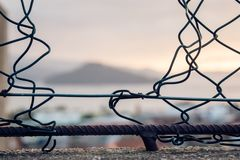 Hole made on a wire fence royalty free stock image