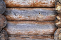 The wall made of wooden logs. Background Stock Photos