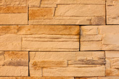 A wall made from yellow bricks. Background Royalty Free Stock Photo
