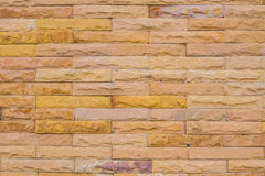 Wall made from yellow sandstone bricks, abstract background Stock Photo
