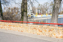 Wall by Malta lake. Small wall made of bricks by the Malta lake in Poznan, Poland Stock Image