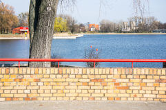 Wall by Malta lake. Small wall made of bricks by the Malta lake in Poznan, Poland Royalty Free Stock Photos