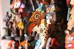 Wall of Masks for Sale in the Market in Antigua Guatemala. A wall of colorful indigenous masks for sale in the market in Antigua Guatemala Royalty Free Stock Image