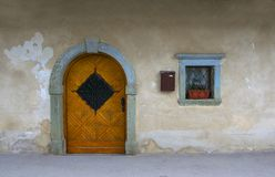 Wall of medieval house in small alpine village in Italy Royalty Free Stock Photos