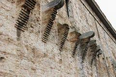 Wall of medieval Sigismondo Castle (Castello Sidzhizmondo) in Ri Stock Images