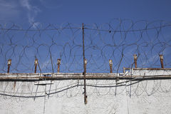 The wall with metal barbed fence Royalty Free Stock Photos