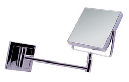 Wall mirror. Wall mounted angle mirror in chrome finish Royalty Free Stock Image