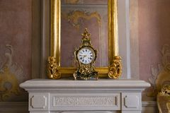 Mirror and clock in Rundale Palace, Latvia. Wall Mirror and clock in Rundāle Palace Latvian. Rundāles pils; German: Schloss Ruhental, formerly Ruhenthal or royalty free stock photography