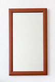 Wall mirror in wooden brown frame Royalty Free Stock Photography