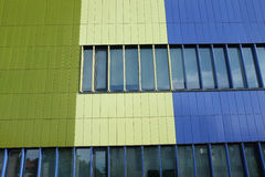 Wall of modern building blue and green color, horizontal photo Royalty Free Stock Photo