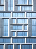 Wall of modern office building of glass and metal in techno style as background Royalty Free Stock Photo
