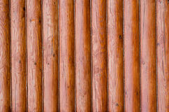 Wall of a modern rural house made of logs insulated with hemp. Wooden background. Royalty Free Stock Images