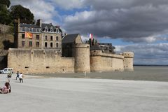 The wall of the mont saint-michel closeup in summer in normandy, france with water in front royalty free stock photos