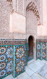 Wall with Moroccoan tiles and ornate wood carvings Royalty Free Stock Photography