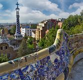 Colorful ceramic bench at Parc Guell designed by Antoni Gaudi, B. Wall Mosaic in garden, colorful ceramic bench at Parc Guell designed by Antoni Gaudi, Barcelona stock photo